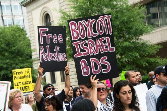 Activists call for boycotting Israel. (Photo via BDSMovement.net)