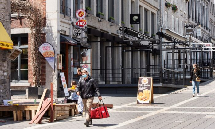 People walk past empty patios in Jacques Cartier Square in Montreal on May 7, 2021. (The Canadian Press/Ryan Remiorz)